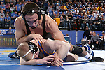 BROOKINGS, SD - DECEMBER 2:  Topher Carton from Iowa rides Henry Pohlmeyer from SDSU in their 141 pound match Friday night at Frost Arena in Brookings, SD.(Photo by Dave Eggen/Inertia)