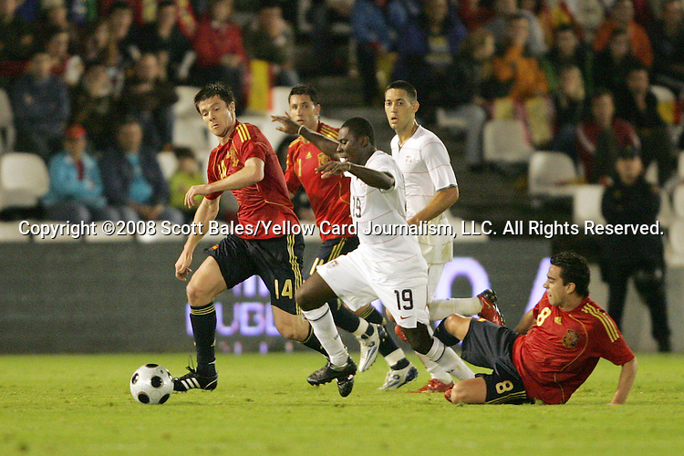 04 June 2008: Freddy Adu (USA) (19) has his legs taken out from under him by a tackle from Xavi (ESP) (8). The Spain Men's National Team defeated the United States Men's National Team 1-0 at Estadio Municipal El Sardinero in Santander, Spain in an international friendly soccer match.