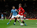 Riyad Marhez of Manchester City tackled by Brandon Williams of Manchester United during the Carabao Cup match at Old Trafford, Manchester. Picture date: 7th January 2020. Picture credit should read: Darren Staples/Sportimage