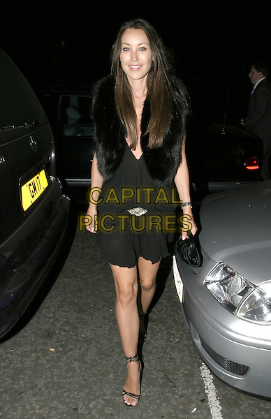 TAMARA MELLON.Dom Perignon VIP Party, 13 Grosvenor Crescent, London, 8th September 2004..full length black dress brooch broach fur jacket gilet.Ref: AH.www.capitalpictures.com.sales@capitalpictures.com.©Capital Pictures.