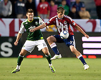 CARSON, CA – June 3, 2011: Chivas USA forward Justin Braun (17) shields the ball from Portland Timbers defender David Horst (12) during the match between Chivas USA and Portland Timbers at the Home Depot Center in Carson, California. Final score Chivas USA 1, Portland Timbers 0.