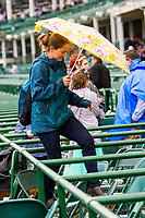 LOUISVILLE,KNY - MAY 04: Agile fan trying to stay dry during Thurby at Churchill Downs, Louisville, Kentucky, May 4, 2017. (Photo by Sue Kawczynski/Eclipse Sportswire/Getty Images)