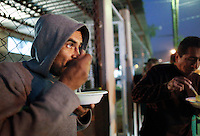 "40 year-old Jose Guadalupe from Guanajuato, Mexico enjoys a free meal outside of ""Casa Migrante"", an immigrant shelter managed by a group of Catholic nuns that provides free meals to the thousands of immigrants and deportees that attempt to cross into the United States each year. Jose was deported over a year ago when he was detained in San Diego while walking on the street - because he wasn't able to provide an ID, he was deported. He has made multiple attempts to cross to reunite himself with his family but has not been able to cross. Because he already stayed four nights in this immigrant shelter, he is occasionally forced to sleep on the street since employment in the region is scarce. ..Increased use of motion sensors, thermal cameras and unmanned drones have made it much harder for would-be migrants to enter certain sections of the border that separates Mexico from the United States...Tecate, Baja California, Mexico - February 7, 2013.  (Javier Manzano / For The Washington Post)."