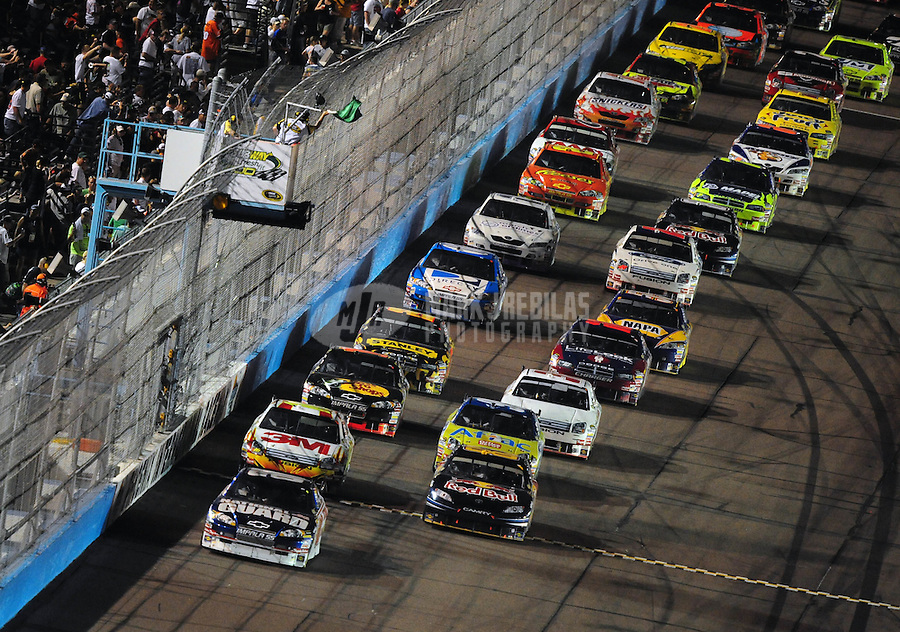 Apr 12, 2008; Avondale, AZ, USA; NASCAR Sprint Cup Series driver Dale Earnhardt Jr (88) leads the field during the Subway Fresh Fit 500 at Phoenix International Raceway. Mandatory Credit: Mark J. Rebilas-
