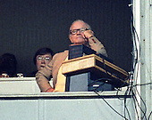 Washington Redskins owner Jack Kent Cooke watches the game action from his box during the game against the Dallas Cowboys at RFK Stadium in Washington, D.C. on November 5, 1988.  The Redskins lost the game 13 - 3.  Redskins general manager Charley Casserly watches from behind Cooke at left.<br /> Credit: Ron Sachs / CNP