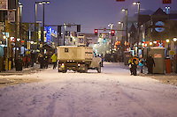 A musher is guided onto 4th avenue by parking volunteers prior to the ceremonial start of the Iditarod sled dog race in downtown Anchorage Saturday, March 2, 2013. ..Photo (C) Jeff Schultz/IditarodPhotos.com  Do not reproduce without permission