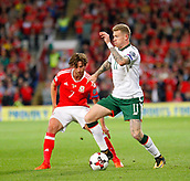 9th October 2017, Cardiff City Stadium, Cardiff, Wales; FIFA World Cup Qualification, Wales versus Republic of Ireland; James McClean (Republic of Ireland) keeps the ball away from Joe Allen (Wales)