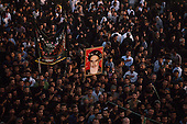 "Tehran, Iran .June 9, 1989..Hundreds of thousands of mourners visit at the grave site for the Grand Ayatullah Sayid Ruhullah Musawi Khomeini in the Beheht-E-Zahra cemetery. He died of heart attack on June 3, 1989...Khomeini was a senior Shi`i Muslim cleric, Islamic philosopher and marja (religious authority), and the political leader of the 1979 Iranian Revolution that saw the overthrow of Mohammad Reza Pahlavi, the last Shah of Iran. Following the revolution, Khomeini became the country's Supreme Leader?the paramount political figure of the new Islamic Republic...Khomeini was a marja al-taqlid, (source of imitation) and important spiritual leader to many Shia Muslims. He was also an innovative Islamic political theorist, most noted for his development of the theory of velayat-e faqih, the ""guardianship of the jurisconsult (clerical authority)"". He was named Time's Man of the Year in 1979 and also one of Time magazine's 100 most influential people of the 20th century."