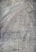 Prehistoric Petroglyph, rock carving, of what is known as the Map of Bebolina with depictions of huts raised on wooden poles and field systems carved by the Camunni people in the iron age between 1000-1600 BC, Rock no 1 , Seradina-Bedolina Archaeological Park, Valle Comenica, Lombardy, Italy