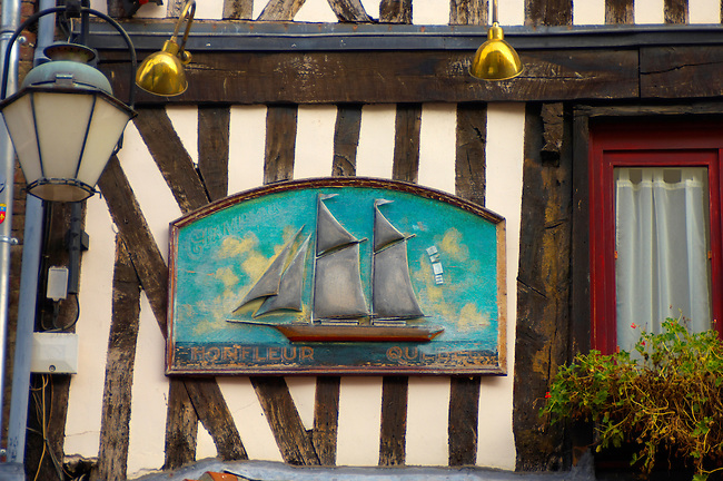 Classic timbered restauarant with signs. Le Champlain. Honfleur, Normandy, France.