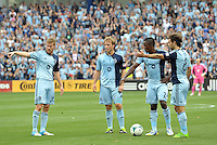 KC players Oriol Rosell, Seth Sinovic, Mechack Jerome and Graham Zusi ponder over a free kick..Sporting Kansas City and Houston Dynamo played to a 1-1 tie at Sporting Park, Kansas City, Kansas.