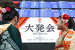 Women wearing traditional Japanese kimonos look at an electronic stock board displaying the first session of the year at the Tokyo Stock Exchange (TSE) on January 4, 2017, Tokyo Japan. The Nikkei Stock Index opened at 19,298.68, higher than the last trading day of 2016. (Photo by Rodrigo Reyes Marin/AFLO)