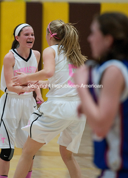 THOMASTON, CT 15 FEBRUARY 2013-021513JS11--Thomaston's Maggie Eberhardt (22) celebrates with teammate Abby Hurlbert (5) during their game against Nonnewaug Friday at Thomaston High School..Jim Shannon Republican-American