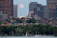 Beacon Hill and state House dome, full moon rising, Boston, MA with sailboat