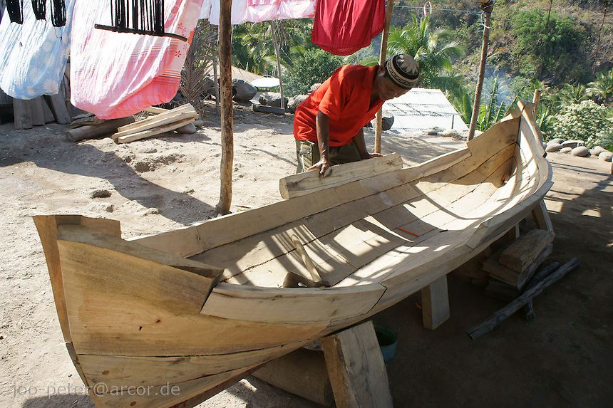man buidling boat in Wolotopo, famous traditional village near coastal city Ende, island  Flores in archipelago of Indonesia