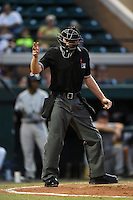 Home plate umpire Matt Winter makes a call during a game between the Tampa Yankees and Lakeland Flying Tigers on April 9, 2015 at Joker Marchant Stadium in Lakeland, Florida.  Tampa defeated Lakeland 2-0.  (Mike Janes/Four Seam Images)