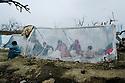 Iran 1991 Family under a plastic tent near Piranshar  Iran 1991 Une famille de refugies kurdes irakiens sous une tente en plastic improvisee