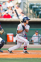 Tzu-Wei Lin (36) of the Greenville Drive follows through on his swing against the Charleston RiverDogs at Joseph P. Riley, Jr. Park on May 26, 2014 in Charleston, South Carolina.  The Drive defeated the RiverDogs 11-3.  (Brian Westerholt/Four Seam Images)