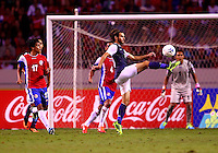 SAN JOSE, COSTA RICA - September 06, 2013: Graham Zusi (19) of the USA MNT kicks the ball clear against the Costa Rica MNT during a 2014 World Cup qualifying match at the National Stadium in San Jose on September 6. USA lost 3-1.