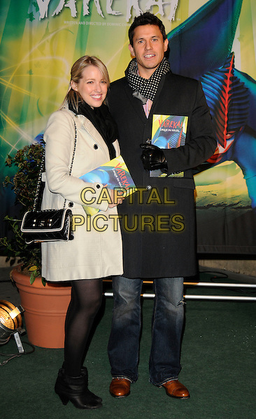 LYDIA & JEREMY EDWARDS.Arrivals at Cirque du Soleil's Varekai gala opening night at the Royal Albert Hall, London, England. .January 5th, 2009 .full length couple black coat beige tights jeans denim bag purse .CAP/CAN.©Can Nguyen/Capital Pictures.