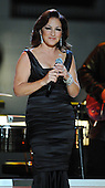 """Washington, DC - October 13, 2009 -- Gloria Estefan walks on to the stage to perform at a White House Music Series """"Fiesta Latina"""" with United States President Barack Obama on the South Lawn of the White House in Washington on Tuesday, October 13, 2009. .Credit: Alexis C. Glenn / Pool via CNP"""