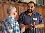 """Demetrius Jordan, adjunct faculty in the Driehaus College of Business, right, talks with Donald Opitz, interim dean of the School for New Learning, during a reception recognizing the contributions of adjunct faculty to the DePaul community, Tuesday, May 8, 2018, in Cortelyou Commons. The """"pep rally"""" style """"RAH-RAHception"""" honored the accomplishments of DePaul's adjuncts and included performances, raffles and give-aways. (DePaul University/Jeff Carrion)"""