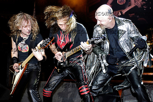 Judas Priest - L-R: KK Downing, Glenn Tipton, Rob Halford - performing live in concert at the benefit for the Teenage Cancer Trust held at the Royal Albert Hall in London UK - 31 March 2006.  Photo credit: George Chin/IconicPix