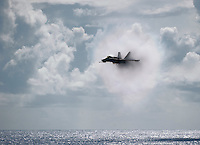 110531-N-DR144-595 PACIFIC OCEAN (May 31, 2011) An F/A-18C Hornet assigned to Strike Fighter Squadron (VFA) 113 is enshrouded in vapor as it exceeds the speed of sound over the Nimitz-class aircraft carrier USS Carl Vinson (CVN 70) during an air power demonstration.  Carl Vinson and Carrier Air Wing (CVW) 17 are underway in the U.S. 7th Fleet area of responsibility. (U.S. Navy photo by Mass Communication Specialist 2nd Class James R. Evans / Released)