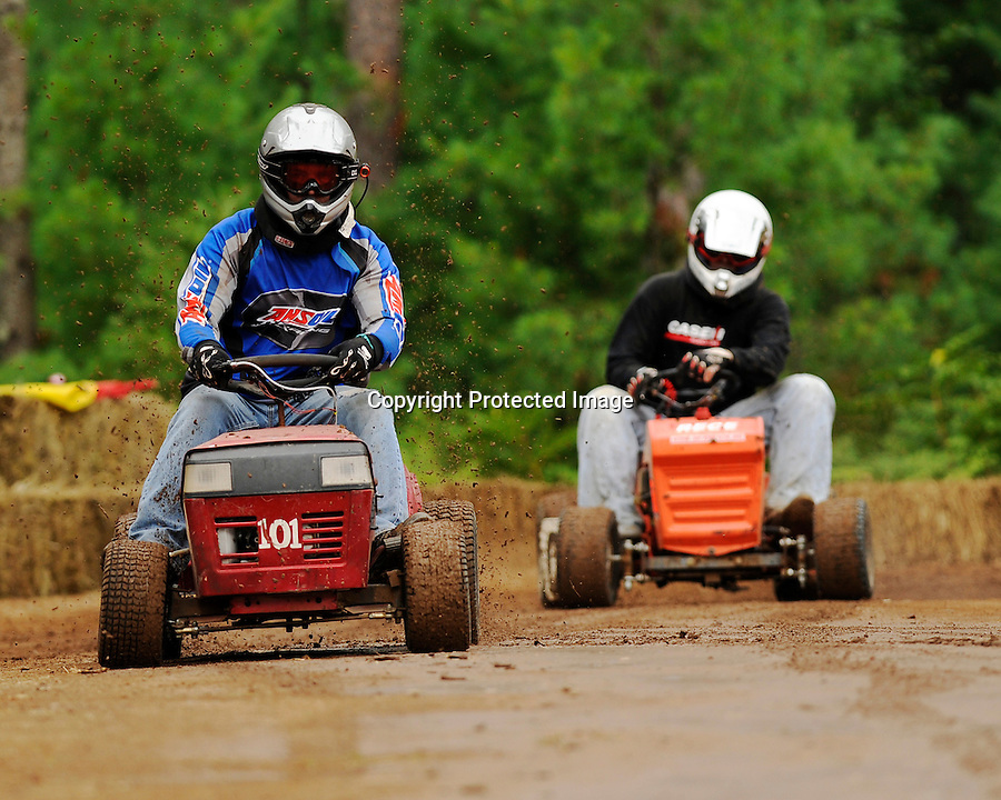 Mark Kellner of Woodruff wins feature race in the International Mower of Weeds (IMOW) class during lawnmower races Aug. 6, 2011 at Fireman's Park, Arbor Vitae.