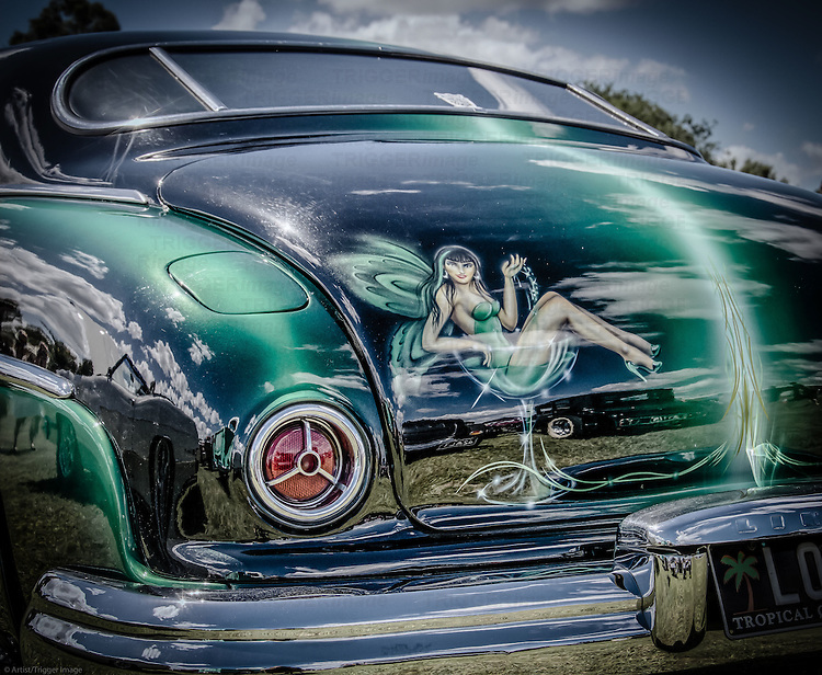 Rear view of classic American car with airbrushed paint work on boot