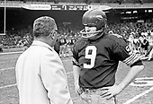 Washington Redskins quarterback Sonny Jurgensen (9), right, and head coach Vince Lombardi, left, discuss strategy on the sidelines during the game against the Los Angeles Rams at RFK Stadium in Washington, D.C. on November 30, 1969.  The Redskins lost the game 24 - 13.<br /> Credit: Arnie Sachs / CNP