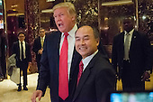 Following a meeting between the two, United States President-elect Donald Trump, left, and Son Masayoshi, CEO and founder of SoftBank,  right, speak with the press in the lobby of Trump Tower in New York, New York, USA on December 6, 2016. <br /> Credit: Albin Lohr-Jones / Pool via CNP