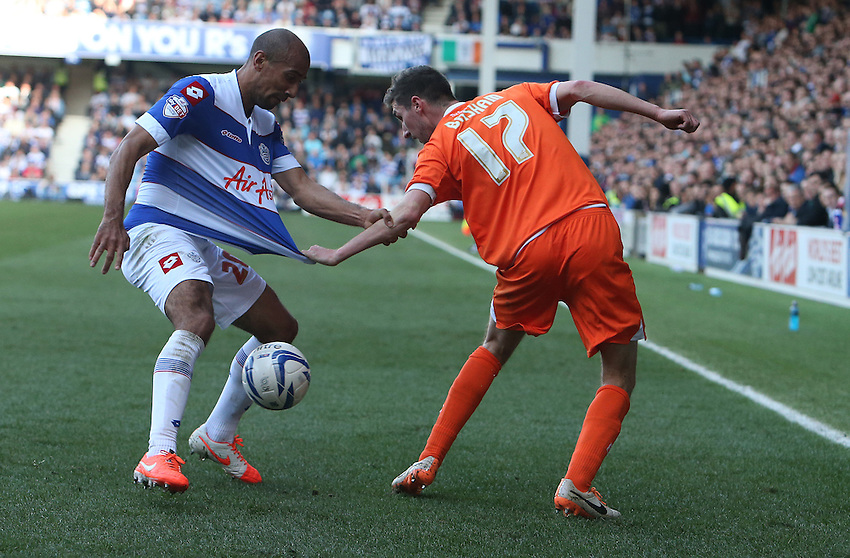 Blackpool's Chris Basham d\ Queens Park Rangers' Danny Simpson<br /> <br /> Photo by Kieran Galvin/CameraSport<br /> <br /> Football - The Football League Sky Bet Championship - Queens Park Rangers v Blackpool - Saturday 29th March 2014 - Loftus Road - London<br /> <br /> &copy; CameraSport - 43 Linden Ave. Countesthorpe. Leicester. England. LE8 5PG - Tel: +44 (0) 116 277 4147 - admin@camerasport.com - www.camerasport.com