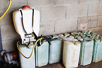 In the winery of Pierre Gaillar: Almost all of the work in the vineyards has to be done by hand (or foot). Spraying, for example, is done carrying this thing on your back and walking along the rows of vines. On top of canisters plastic containers of chemicals to spray with.  Domaine Pierre Gaillard, Malleval, Ardeche, ardèche, France, Europe
