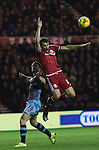 Cristhian Stuani of Middlesbrough jumping over Rhoys Wiggins of Sheffield Wednesday to head the ball - Sky Bet Championship - Middlesbrough vs Sheffield Wednesday - Riverside Stadium - Middlesbrough - England - 28th of December 2015 - Picture Jamie Tyerman/Sportimage