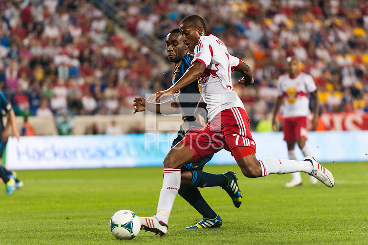 Roy Miller (7) of the New York Red Bulls is marked by Amobi Okugo (14) of the Philadelphia Union. The New York Red Bulls and the Philadelphia Union played to a 0-0 tie during a Major League Soccer (MLS) match at Red Bull Arena in Harrison, NJ, on August 17, 2013.