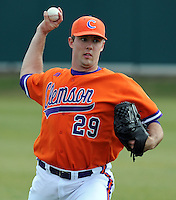 Pitcher David Haselden (29) of the Clemson Tigers warms up prior to a game against the Eastern Michigan Eagles on Friday, Feb. 18, 2011, at Doug Kingsmore Stadium in Clemson, S.C.  Photo by: Tom Priddy/Four Seam Images