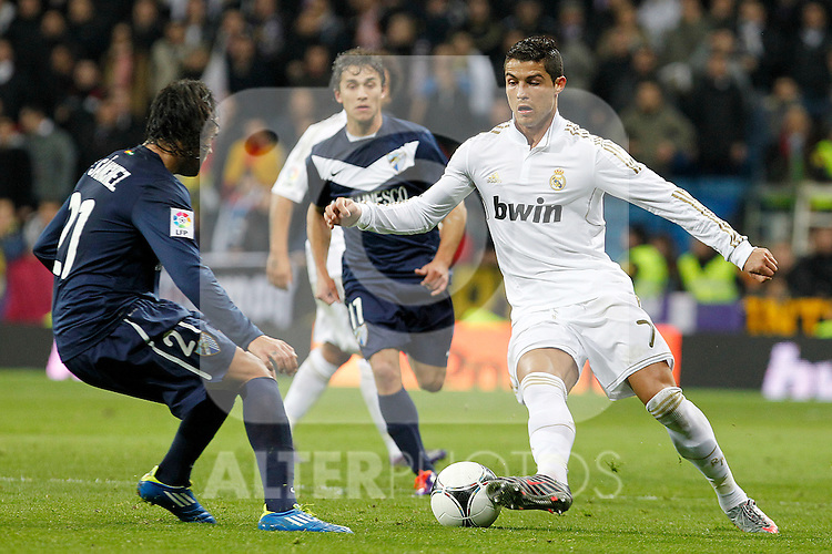 Real Madrid's Cristiano Ronaldo (r) and Malaga's Sergio Sanchez during Spanish King's Cup match.January 3,2011. (ALTERPHOTOS/Acero)