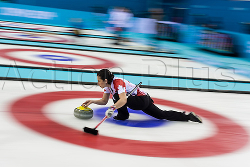 19.02.2014 Sochi, Krasnodar Krai, Russia.   Canada's Jill OFFICER delivers a stone during the semifinal of the Women's Curling competition between Great Britain and Canada from the Ice Cube Curling Centre, Coastal Clustre - XXII Olympic Winter Games