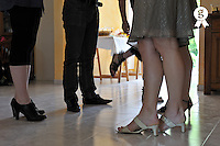 Legs of people talking together nearby the buffet (Licence this image exclusively with Getty: http://www.gettyimages.com/detail/110048302 )