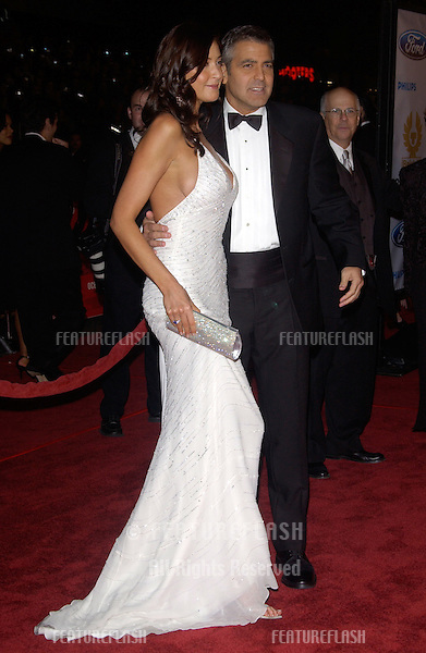 Dec 8, 2004; Los Angeles, CA: Actor GEORGE CLOONEY & girlfriend actress/model LISA SNOWDON at the Hollywood premiere of his new movie Ocean's Twelve..