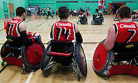 15 AUG 2011 - LEEDS, GBR - Canadian squad members wait on the sideline for a chance to play during the wheelchair rugby exhibition match between Great Britain and Canada .(PHOTO (C) NIGEL FARROW)