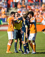 Tempers flare between Houston Dynamo forward Brian Ching (25) and Los Angeles Galaxy defender Gregg Berhalter (16) as Los Angeles Galaxy midfielder Eddie Lewis (6) and Houston Dynamo forward Luis Angel Landin (7) attempt to calm things. Houston Dynamo tied Los Angeles Galaxy 0-0 at Robertson Stadium in Houston, TX on October 18, 2009.
