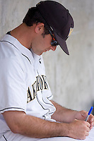 Wake Forest Demon Deacons coach Grant Achilles #29 makes notes prior to the game against the Duke Blue Devils at the Wake Forest Baseball Park April 23, 2010, in Winston-Salem, NC.  Photo by Brian Westerholt / Sports On Film