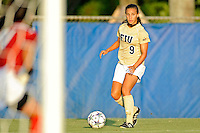 27 August 2011:  FIU's Ashleigh Shim (9) passes the ball in the first half as the FIU Golden Panthers defeated the University of Arkon Zips, 1-0, at University Park Stadium in Miami, Florida.