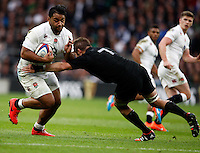 Photo: Richard Lane/Richard Lane Photography. England v New Zealand. QBE Autumn International. 08/11/2014. England's Billy Vinipola is tackled by New Zealand's Richie McCaw.