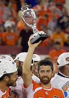 Houston Dynamo team captain Wade Barrett hoists the Western Conference championship trophy.  Houston Dynamo beat the Colorado Rapids 3-1 to clinch the Western Conference Championship at Robertson Stadium in Houston, TX on November 5, 2006.