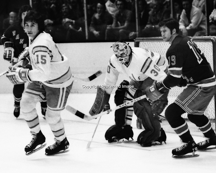 """California Golden Seals vs New York Rangers 1974.<br /> Jim Neilson, Ranger Jean Ratelle, and Seals goalie Gary Simmons """"the Cobra""""(photo/Ron Riesterer)"""