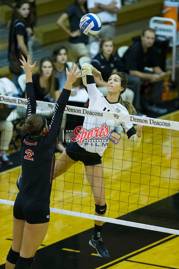Hanna Lee (16) of the Wake Forest Demon Deacons attacks the ball during the match against the Georgia Bulldogs in Reynolds Gymnasium on September 18, 2015 in Winston-Salem, North Carolina.  The Demon Deacons defeated the Bulldogs 3-1.   (Brian Westerholt/Sports On Film)