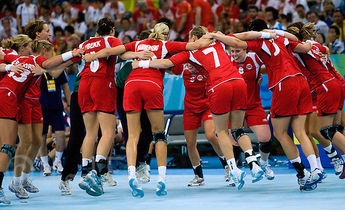 23 AUG 2008 - BEIJING, CHN - The Norwegian team celebrate beating Russia in the Womens Team Handball final - Beijing Olympics. (PHOTO (C) NIGEL FARROW) *** IOC RULES APPLY ON USAGE ***